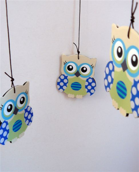 Blue owls on a cross header